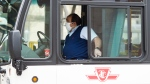 A TTC worker wears a mask in a bus while on shift in Toronto on Thursday, April 23, 2020. TTC officials have said that they will lay off 1,200 workers temporarily due to the COVID-19 pandemic. THE CANADIAN PRESS/Nathan Denette