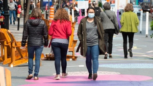 Pedestrians make their way along St. Catherine street in Montreal, Tuesday, Sept. 15, 2020. Montreal as well as three other regions of the province have been upgraded to yellow under Quebec's colour-coded alert system.THE CANADIAN PRESS/Ryan Remiorz