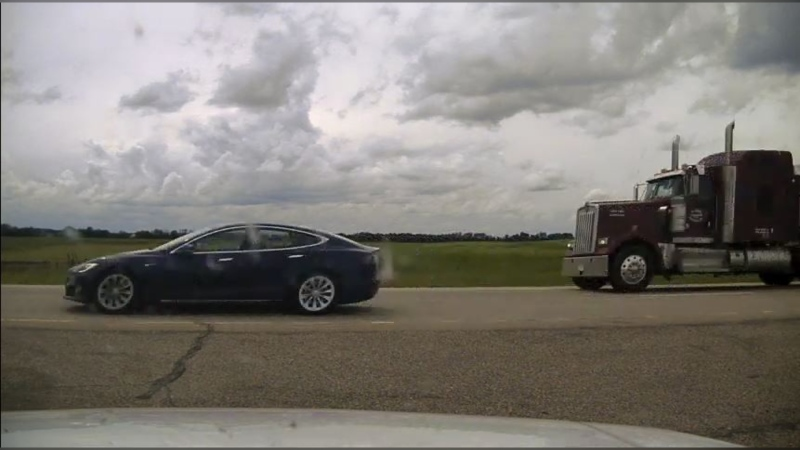 Alberta RCMP say a driver reported a Tesla speeding on Highway 2 near Ponoka on July 9. According to the caller, and the responding Mountie, both the driver's seat and passenger's seat were fully reclined. (Photo provided by RCMP.)