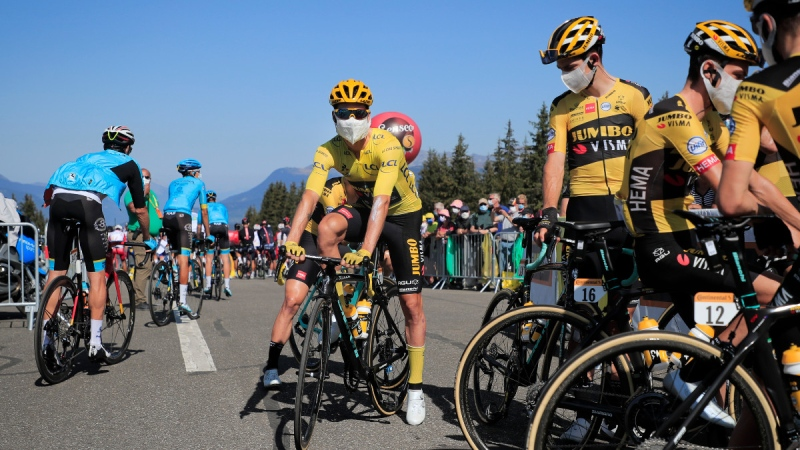 Primoz Roglic, wearing the overall leader's yellow jersey, centre, prior to the start of stage 18 of the Tour de France, on Sept. 17, 2020. (Christophe Petit-Tesson / Pool via AP)