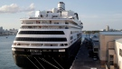 An ambulance leaves as Carnival's Holland America cruise ship Zaandam is docked at Port Everglades during the coronavirus pandemic, Thursday, April 2, 2020, in Fort Lauderdale, Fla. Those passengers who are fit for travel in accordance with guidelines from the U.S. Centers for Disease Control will be permitted to disembark. (AP Photo/Lynne Sladky)
