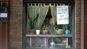 """Lee"" is pictured at the window of her west Toronto apartment on Thursday March 19, 2020. THE CANADIAN PRESS/Chris Young"