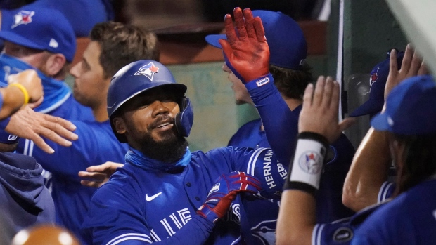 Toronto Blue Jays' Teoscar Hernandez is congratulated by teammates after his three-run home run, breaking a 2-2 tie, in 10th inning of a baseball game against the Boston Red Sox, Thursday Sept. 3, 2020, in Boston. THE CANADIAN PRESS/AP/Charles Krupa