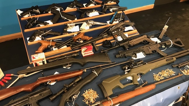 Police say 36 replica firearms as well as one real .303 rifle were seized from a home in Langford Tuesday: (CTV News)
