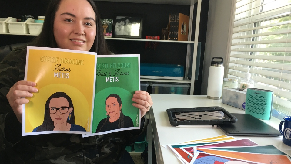 Artist and educator Megan Tipler shows off her illustrations of lesser-known Indigenous role models. (Darcy Seaton/CTV News Edmonton)