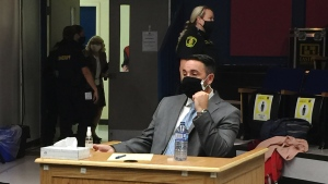Douglas Snelgrove sits prior to the start of his trial at a St. John's school on Wednesday, September 16, 2020.  (THE CANADIAN PRESS/Sarah Smellie)