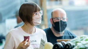 In this file photo, two people with glasses wear face masks as they shop at a market in Montreal, Sunday, Sept. 13, 2020, as the COVID-19 pandemic continues in Canada and around the world. THE CANADIAN PRESS/Graham Hughes