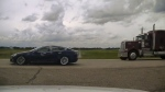 A Tesla Model S with the seats fully reclined is seen in this handout photo provided by Alberta RCMP.