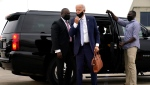 Democratic presidential candidate former Vice President Joe Biden arrives to board a plane at New Castle Airport in New Castle, Del., Thursday, Sept. 17, 2020, en route to participate in a CNN town hall moderated by CNN's Anderson Cooper in Moosic, Pa. (AP Photo/Carolyn Kaster)