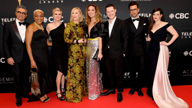 """Cast members of """"Schitt's Creek"""" pose on the red carpet at the Canadian Screen Awards in Toronto on March 31, 2019. (THE CANADIAN PRESS/Nathan Denette)"""