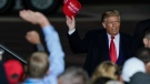 U.S. President Donald Trump throws a hat to the crowd after speaking at a campaign rally at the Central Wisconsin Airport Thursday, Sept. 17, 2020, in Mosinee, Wis. (AP Photo/Morry Gash)