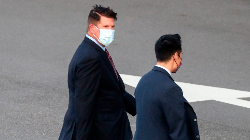 In this Sept. 17, 2020, file photo, U.S. Undersecretary of State Keith Krach, walks away after disembarking from a plane upon arrival at an airforce base in Taipei. Taiwan. (Pool Photo via AP Photo, File)