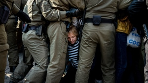 Police officers block and detain protesters during an opposition rally to protest the official presidential election results in Minsk, Belarus, Saturday, Sept. 12, 2020. (AP Photo/Misha Friedman)