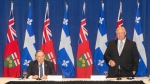 Ontario Premier Doug Ford stands alongside Quebec Premier Francois Legault, as he speaks to the media, at the start of the Ontario-Quebec Summit, in Toronto, on September 9, 2020. (THE CANADIAN PRESS/Chris Young)