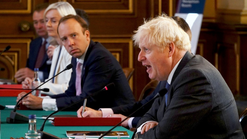 Britain's Prime Minister Boris Johnson, right, chairs a socially distanced government Cabinet meeting at the Foreign and Commonwealth Office (FCO) in London, Tuesday Sept. 15, 2020. Health Secretary Matt Hancock, centre, and International Trade Secretary Liz Truss, 2nd left. (Jonathan Buckmaster / Pool via AP)