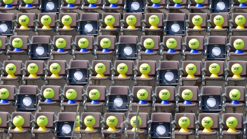 Giant tennis balls are placed on the tribune seats at the Italian Open tennis tournament, in Rome, on Sept. 18, 2020. (Alfredo Falcone / LaPresse via AP)