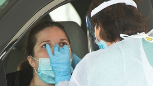 A woman gets tested at a drive through clinic Wednesday, September 16, 2020 in Longueuil, Que. THE CANADIAN PRESS/Ryan Remiorz