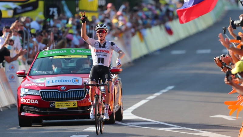 Soren Kragh Andersen crosses the line to win the 19th stage of the Tour de France, on Sept. 3, 2020. (Marco Bertorello / Pool via AP)