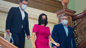 Gatineau Mayor Maxime Pedneaud-Jobin, left, Montreal Mayor Valerie Plante and Quebec City Mayor Regis Labeaume, right, arrive at a news conference Friday, September 18, 2020 in Montreal.THE CANADIAN PRESS/Ryan Remiorz