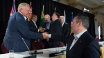 Alberta Premier Jason Kenney shakes hands with Ontario Premier Doug Ford following a closing news conference at a meeting of Canada's Premiers in Saskatoon, Sask. Thursday, July 11, 2019. THE CANADIAN PRESS/Jonathan Hayward