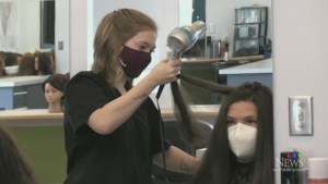 Aspiring hairstylists resume in-person training