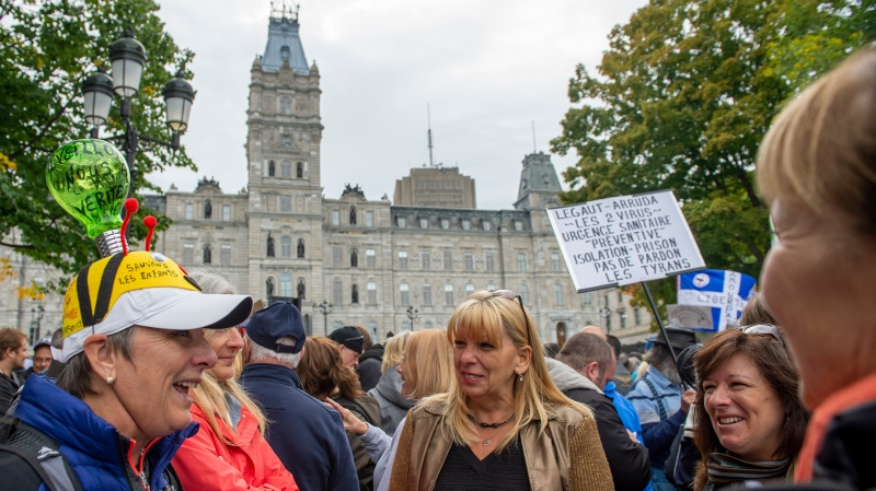 Demonstrators protest against measures to stop the transmission of COVID-19 at the National Assembly in Quebec City, Tuesday, Sept. 15, 2020. THE CANADIAN PRESS/Jacques Boissinot