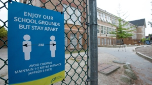 A physical distancing sign is seen during a media tour of Hastings Elementary School in Vancouver on Sept. 2, 2020. (Jonathan Hayward / THE CANADIAN PRESS)