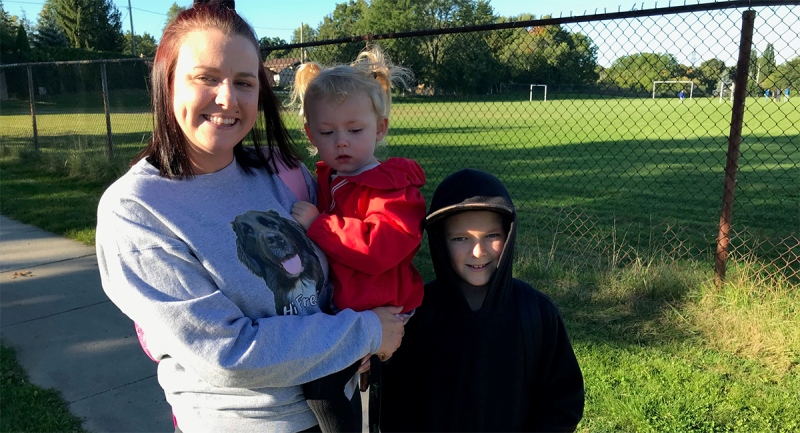 Megan Barclay stands near Glen Cairn Public School in London, Ont. with her two children on Friday, Sept. 18, 2020. (Sean Irvine / CTV News)