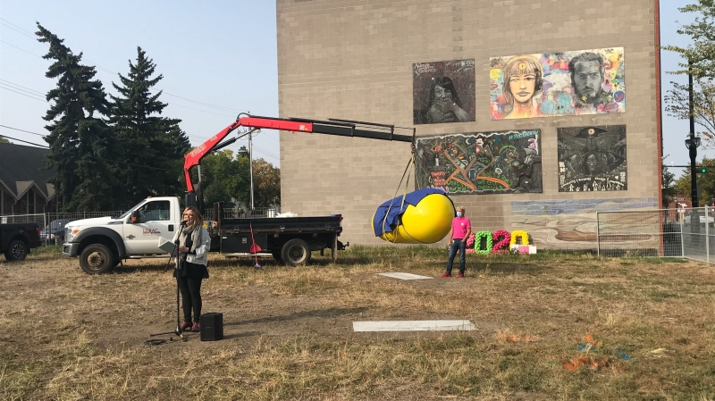 "One of the ""Love Your Bean"" sculptures being installed on Alberta Avenue. Sept. 18, 2020. (Brandon Lynch/CTV News Edmonton)"