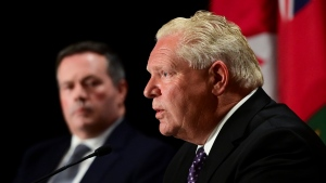 Ontario Premier Doug Ford speaks as Alberta Premier Jason Kenney looks on during a press conference in Ottawa on Friday, Sept. 18, 2020. (Sean Kilpatrick/THE CANADIAN PRESS)