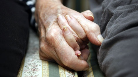 Jeannette Zeltzer, 81 and her new boyfriend Max Rakov, 92, hold hands while sitting on a couch at the assisted living facility where they live on Saturday, March 8, 2008 in Newton, Mass. Zeltzer recently lost her husband and now spends time holding hands with Rakov who also suffers from Alzheimer's. (AP Photo/Greg M. Cooper)