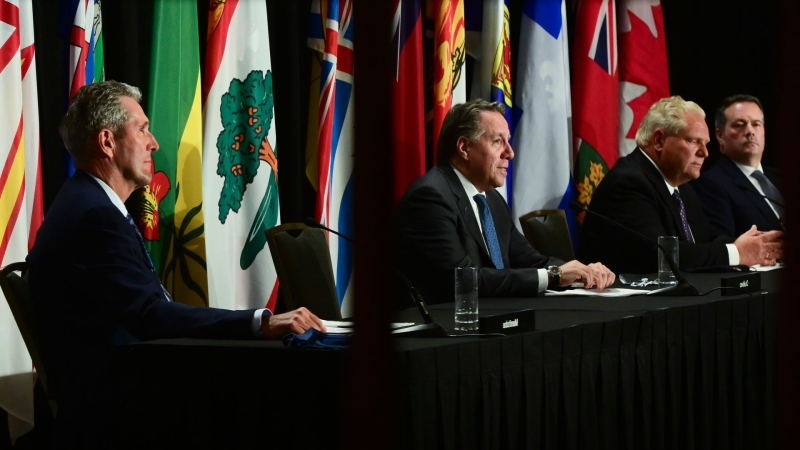 Quebec Premier Francois Legault, second left, speaks as Manitoba Premier Brian Pallister Ontario Premier Doug Ford and Alberta Premier Jason Kenney are reflected in a mirror as they hold a press conference in Ottawa on Friday, Sept. 18, 2020. THE CANADIAN PRESS/Sean Kilpatrick