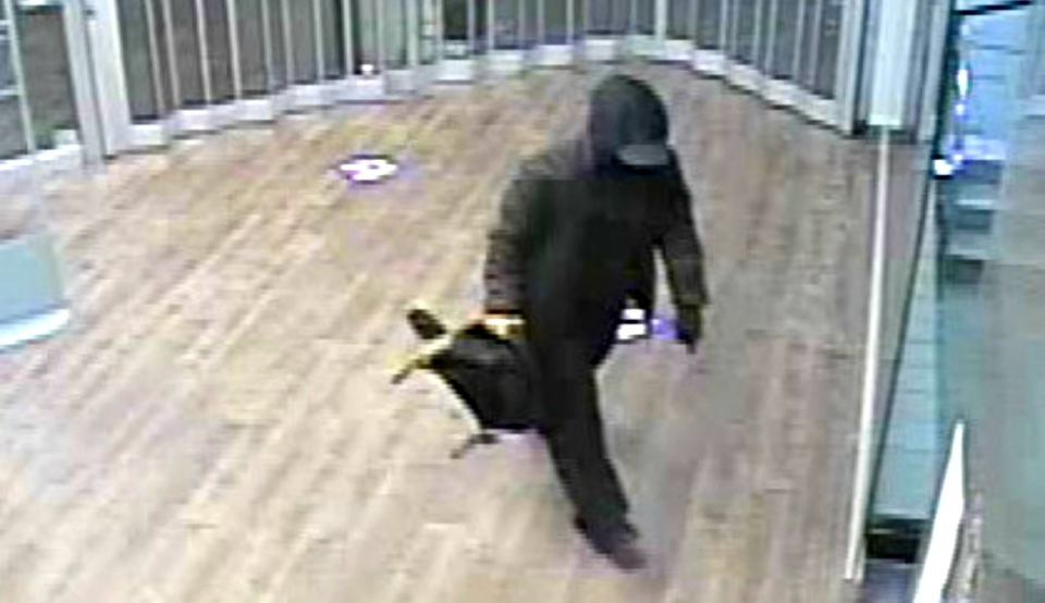Timmins police have release images of a suspect who entered the RBC bank in Timmins on Thursday night and started a fire in the vestibule next to the bank machine .(Supplied)