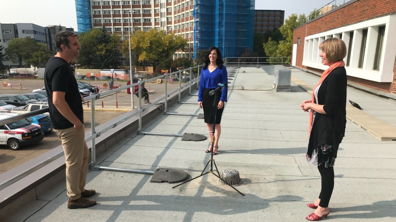CTV News Edmonton's Graham Neil talking to soprano Cara McLeod and pianist Leanne Regehr on the rooftop that will be their stage Saturday. Sept. 18, 2020. (Galen McDougall/CTV News Edmonton)