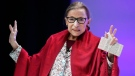 FILE - In this Oct. 3, 2019 file photo, U.S. Supreme Court Justice Ruth Bader Ginsburg gestures to students before she speaks at Amherst College in Amherst, Mass. Ginsburg usually is on the receiving end of awards, but she'll be handing out one in her name next week to a prominent philanthropist.