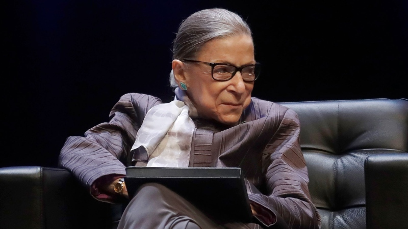FILE - In this Oct. 21, 2019, file photo U.S. Supreme Court Justice Ruth Bader Ginsburg listens to speakers during the inaugural Herma Hill Kay Memorial Lecture at the University of California at Berkeley in Berkeley, Calif. (AP / Jeff Chiu, File)