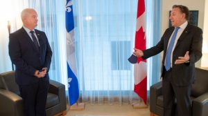 Federal Conservative Leader Erin O'Toole, left, and Quebec Premier Francois Legault get set to start their meeting in Montreal, Monday, Sept. 14, 2020. THE CANADIAN PRESS/Ryan Remiorz