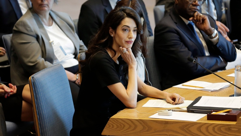 Amal Clooney listens during a Security Council meeting on sexual violence at United Nations headquarters, Tuesday, April 23, 2019. (AP Photo/Seth Wenig)