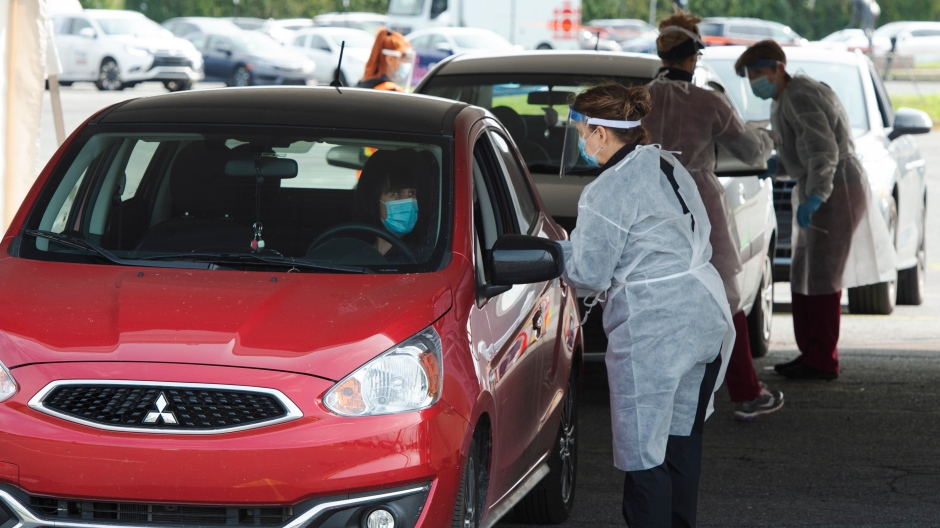 People wait to get tested at a drive through COVID-19 clinic Wednesday, September 16, 2020 in Longueuil, Que. THE CANADIAN PRESS/Ryan Remiorz