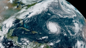 "This GOES-16 GeoColor satellite image taken Friday, Sept. 18, 2020, at 12:20 p.m. EDT., and provided by NOAA, shows Hurricane Teddy, center, in the Atlantic, Tropical Depression 22, left, in the Gulf of Mexico, the remnants Paulette, top right, and Tropical Storm Wilfred, lower right. Forecasters have run out of traditional names for the Atlantic hurricane season. Tropical Storm Wilfred, the last of traditional names, officially formed little more than an hour before subtropical storm Alpha, prompting the hurricane center to tweet ""get out the Greek alphabet."" (NOAA via AP)"