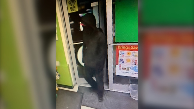 Police say the suspect was wearing a dark winter jacket, a black mask, a wine-coloured baseball hat and carrying a black bag. Additionally, police describe the suspect as a white male in his mid-20s, around 5-foot-8, with a medium build. (Courtesy RCMP)