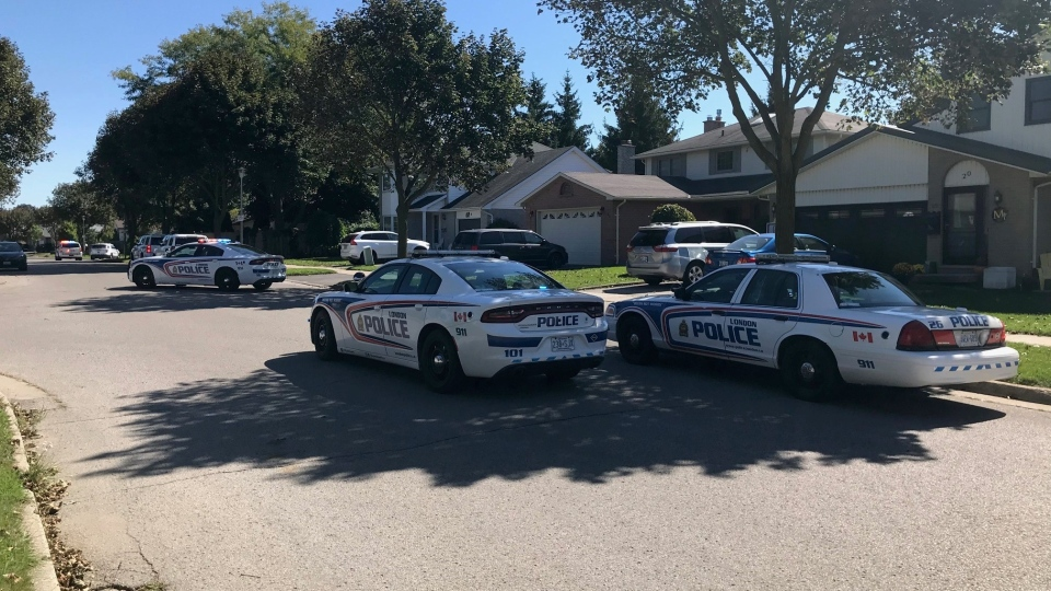 Police cruisers are seen in the area of Bexhill Drive and Sloane Crescent in London, Ont. on Saturday, Sept. 19, 2020.