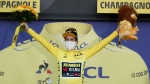 Slovenia's Primoz Roglic, wearing the leaders yellow jersey celebrates on the podium after the 19th stage of the Tour de France cycling race over 166.5 kilometers between Bourg-En-Bresse and Champagole, France Friday, Sept. 3, 2020. (Benoit Tessier/Pool via AP)