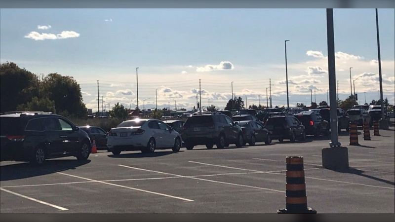 A long line of cars wait for testing at a COVID-19 pop-up testing site at Canadian Tire Centre. (Claudia Cautillo/CTV News Ottawa)