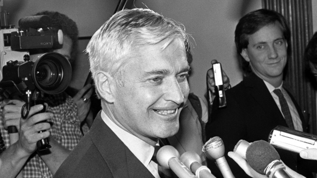 "Prime Minister John Turner talks with media reporters after being sworn in as the Member of Parliament for Vancouver Quadra in Ottawa Sept. 17, 1984. Former prime minister Turner, dubbed ""Canada's Kennedy"" when he first arrived in Ottawa in the 1960s, has died at the age of 91.THE CANADIAN PRESS/Chuck Mitchell"