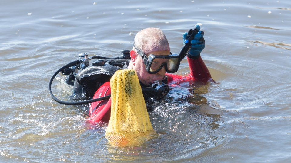 Diver cleaning up the St. Larence River