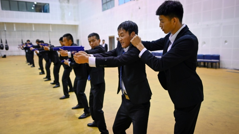 The guns at the Tianjin school are fake because China outlaws possession of firearms. (AFP)