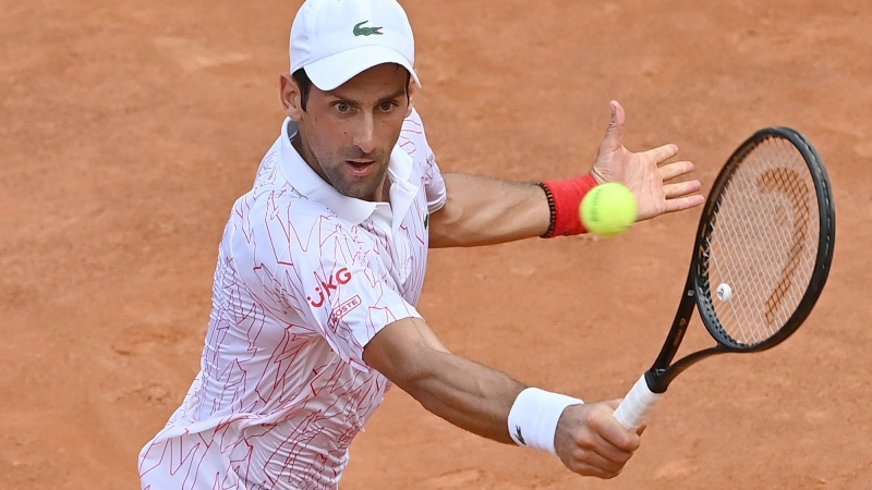 Serbia's Novak Djokovic returns the ball to Germany's Dominik Koepfer during their quarterfinal match at the Italian Open tennis tournament, in Rome, Saturday, Sept. 19, 2020. (Alfredo Falcone/LaPresse via AP)