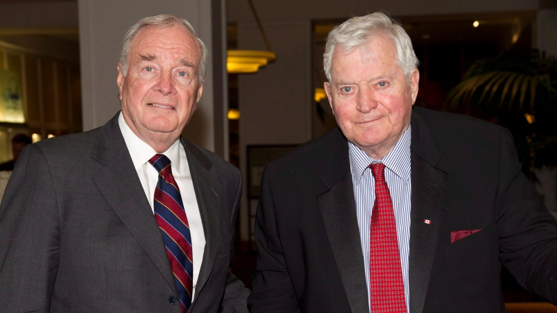 Former prime ministers Paul Martin, left, and John Turner arrive at a luncheon in Montreal on Monday, June 18, 2012. Turner's presentation, John Turner - Examining Five Decades in Politics, was moderated by Martin. THE CANADIAN PRESS/Paul Chiasson