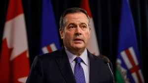 Jason Kenney is at home in self-isolation after learning of a positive case of COVID-19 in one of his ministers. (File)